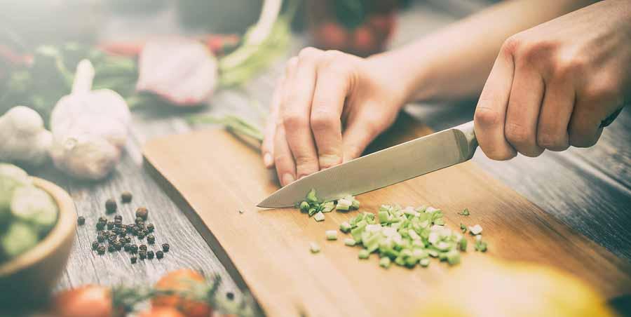 chef cooking food kitchen restaurant cutting prepare cook hands healthy hotel